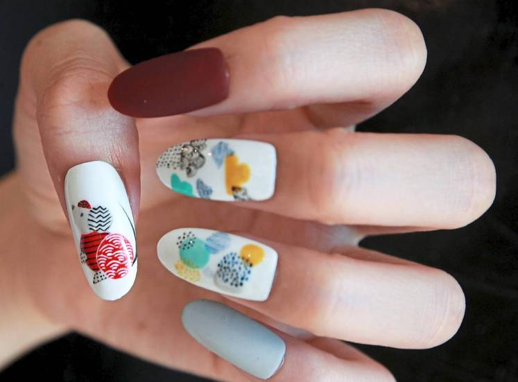 Nail artist Chow Cha Yee has created a modern minimalist style with a hint of oriental illustration of the rat, complemented with Chinese landscape paintings. — NORAFIFI EHSAN/The Star