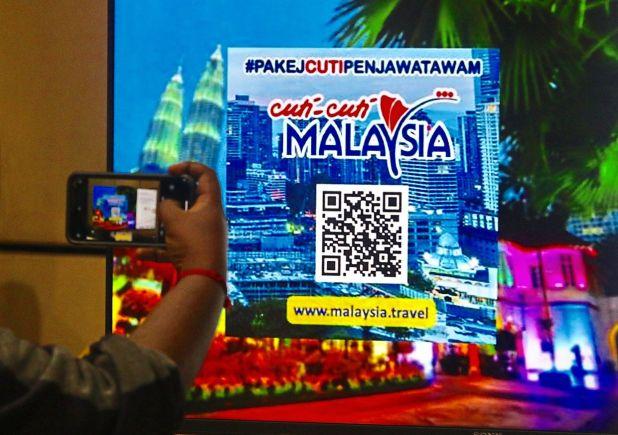 去往的地方:吉隆坡国内旅行泡沫新闻发布会上的旅行促销。 — FAIHAN GHANI /星