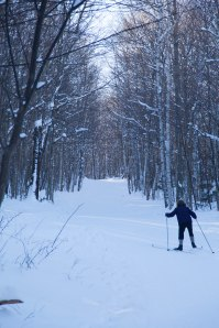 cross country skier going uphill