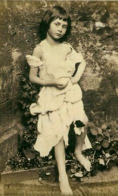 This photo of Alice, entitled The Beggar Maid, was taken at Ravensworth Castle in 1858 by Lewis Carrol.