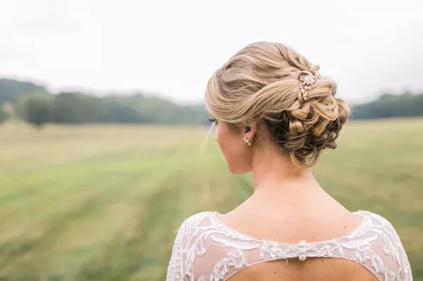 elegant curled low updo with pearl hair accessory