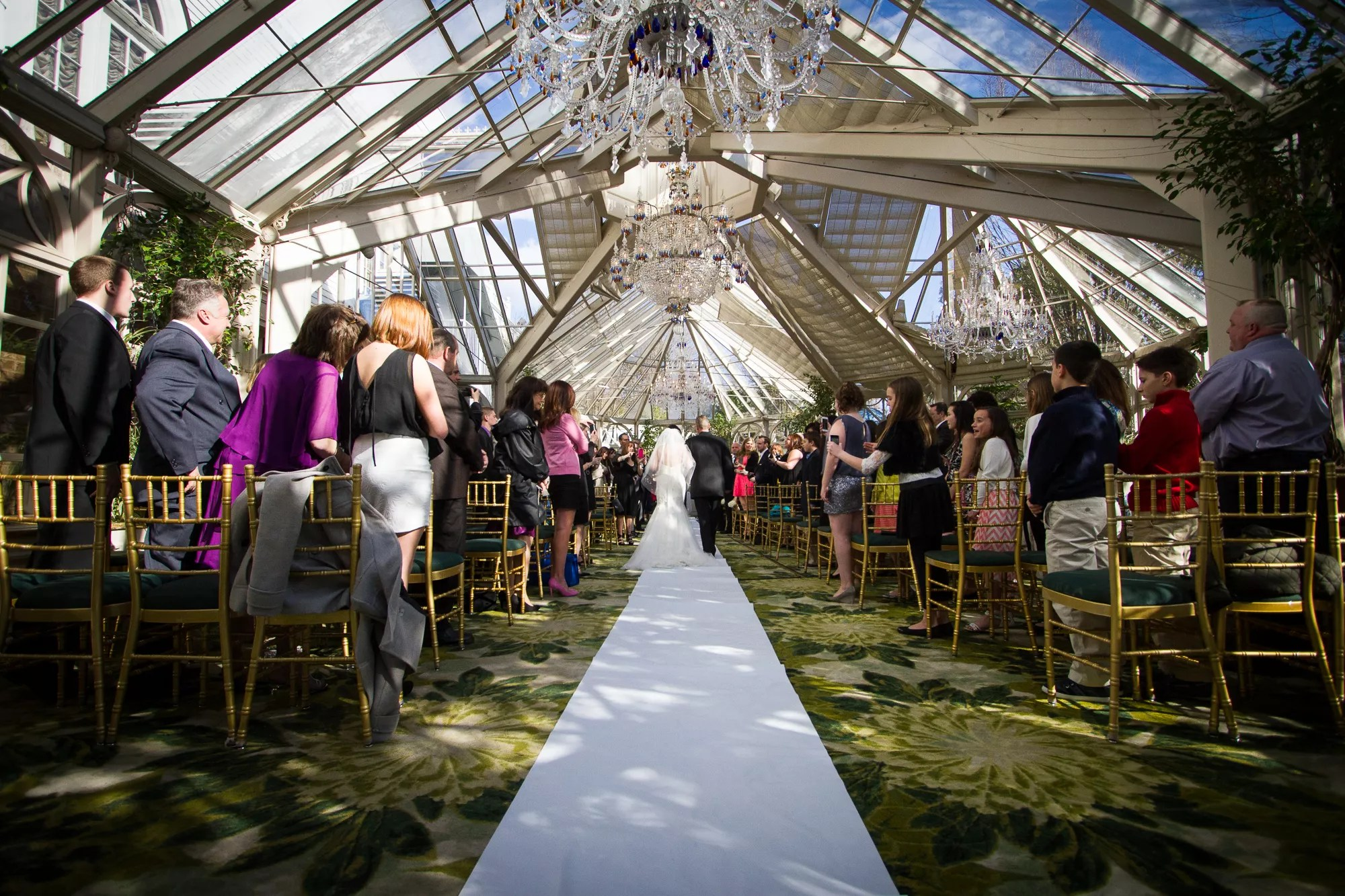 The Conservatory Ceremony With Chandeliers At The Brownstone