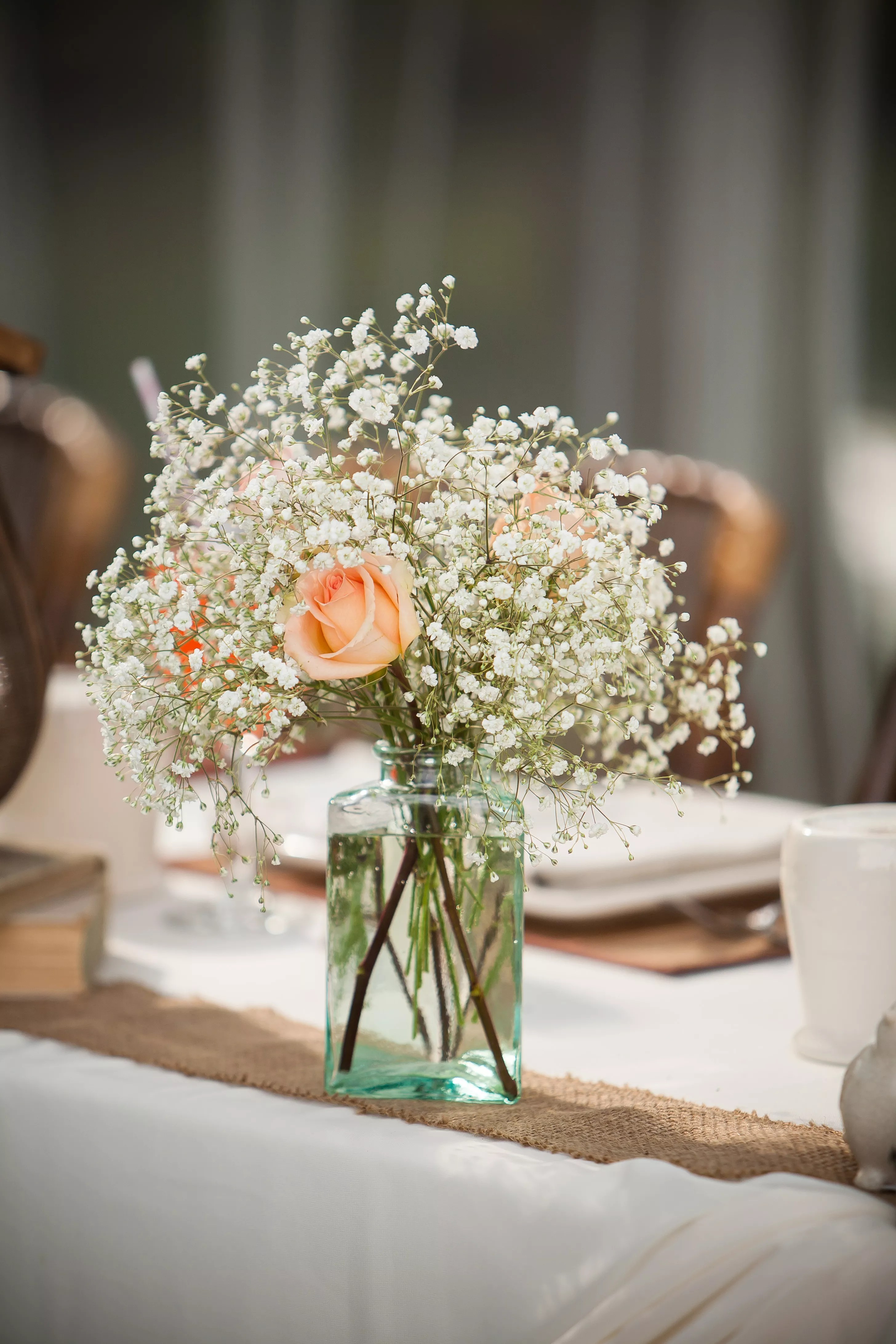 Peach Rose And Baby S Breath Centerpiece