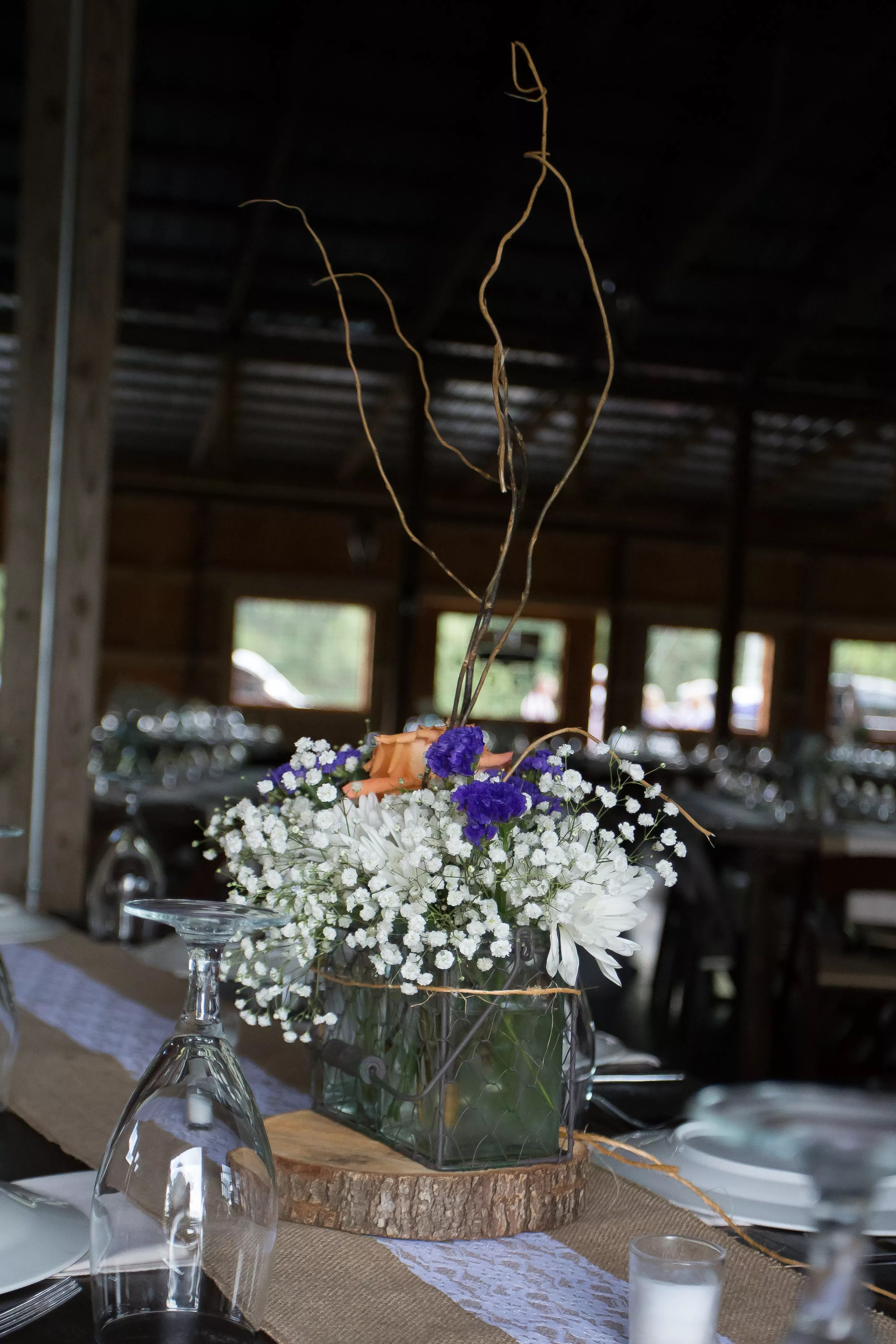 Rustic Baby S Breath And Branch Centerpieces With Purple And Orange Flowers