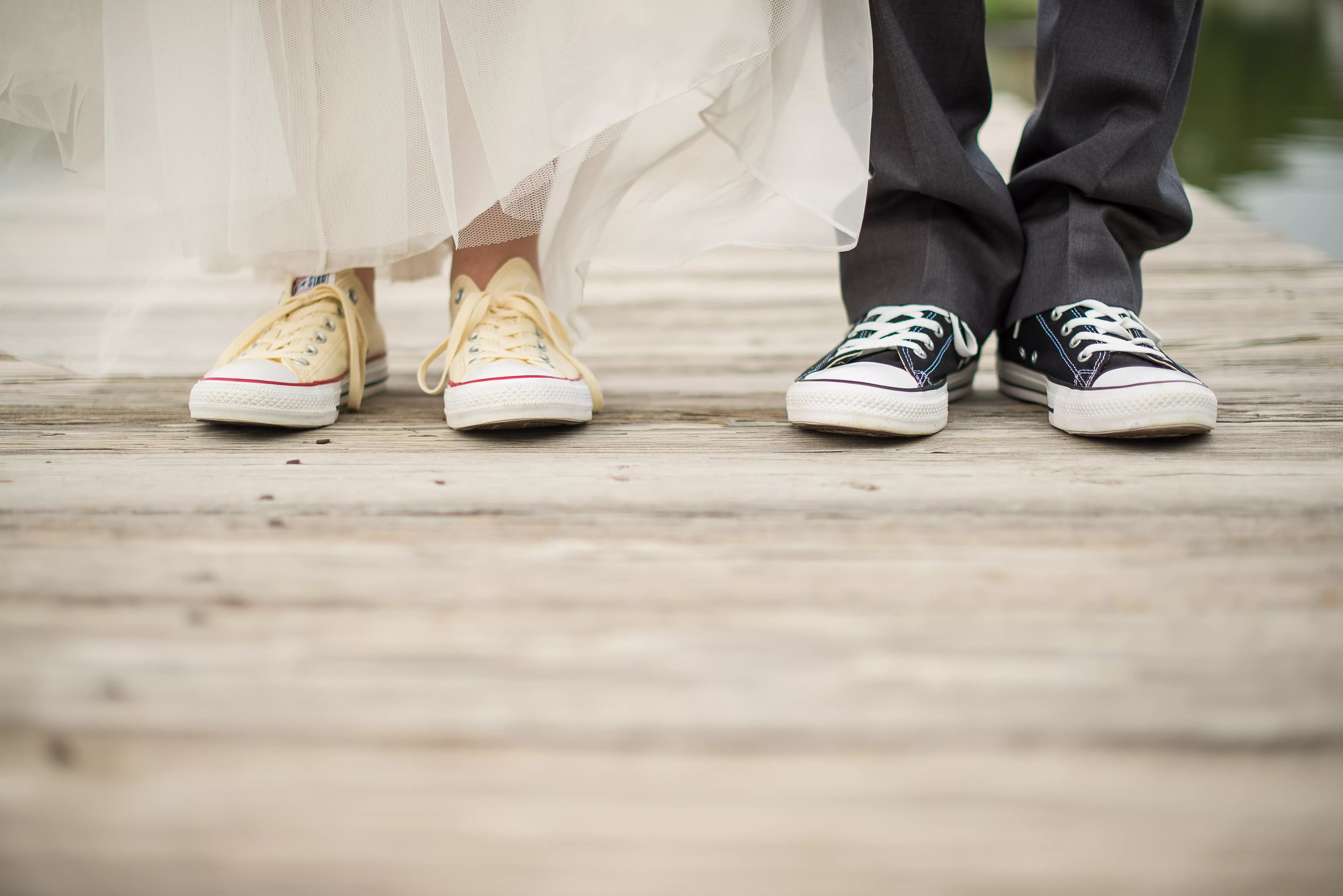 Bride And Groom Wearing Chuck Taylor Converse Shoes