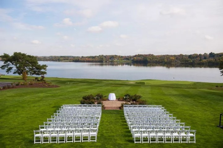 A Vintage  Aviation Inspired Wedding at The Lake Club in Poland  Ohio The ceremony took place on the lawn of The Lake Club in Poland  Ohio