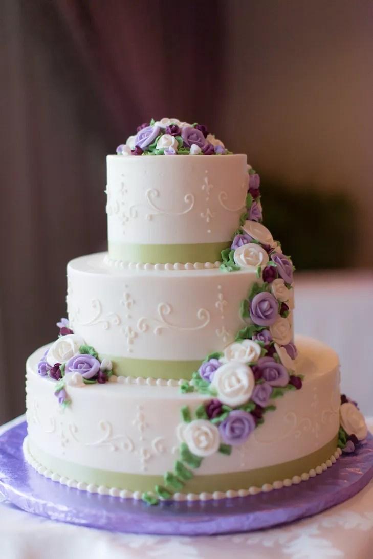 White Wedding Cake With Purple Sugar Flowers