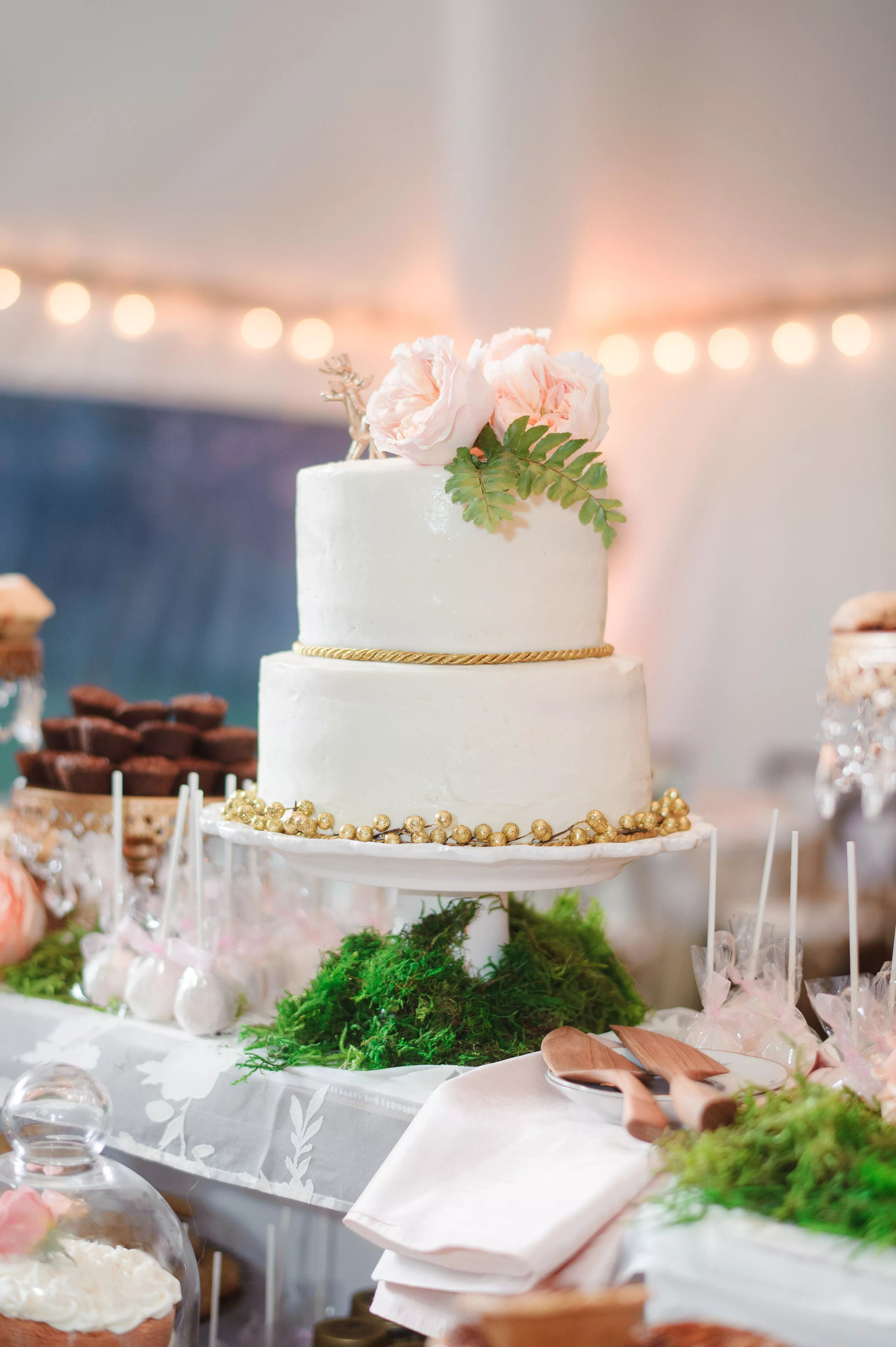 Tiered White Wedding Cake With Gold Accents