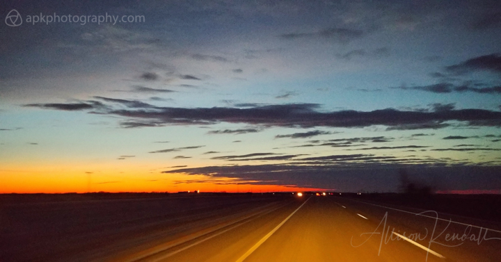 Vivid winter sunset on the Canadian highway, across the prairie of Manitoba and Saskatchewan