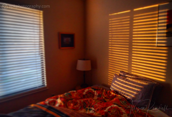 Warm winter sunset light filters into a quiet bedroom