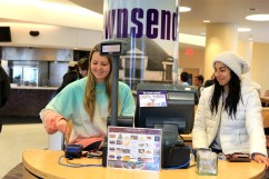 Milton Daniel resident assistants, Kacey Williamson and Selina Rodriguez, help swipe-in students during lunchtime in Market Square on Feb. 23. (TCU 360/Alexandra Plancarte)