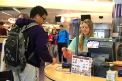 Milton Daniel resident assistant Kacey Williamson helps swipe-in students during lunchtime in Market Square on Feb. 23. (TCU360/Alexandra Plancarte)(TCU 360/Alexandra Plancarte)