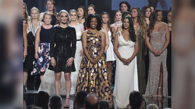 (Photo by Phil McCarten/Invision/AP) Former gymnast Sarah Klein, former Michigan State softball player Tiffany Thomas Lopez and gymnast Aly Raisman, from left in front, and others who suffered sexual abuse accept the Arthur Ashe Award for Courage.