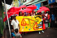 """march through streets of Kolkata carrying banner with slogan """"pepfar kills sex workers"""""""