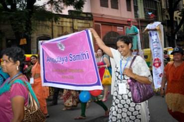 marchers carry banner of Ashodaya Samithi