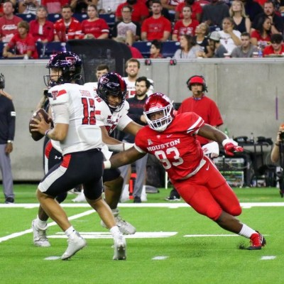 UH defensive lineman Atlias Bell chases down Texas Tech quarterback Tyler Shough during Saturday's game at NRG Stadium. (Courtesy Mario Puente)