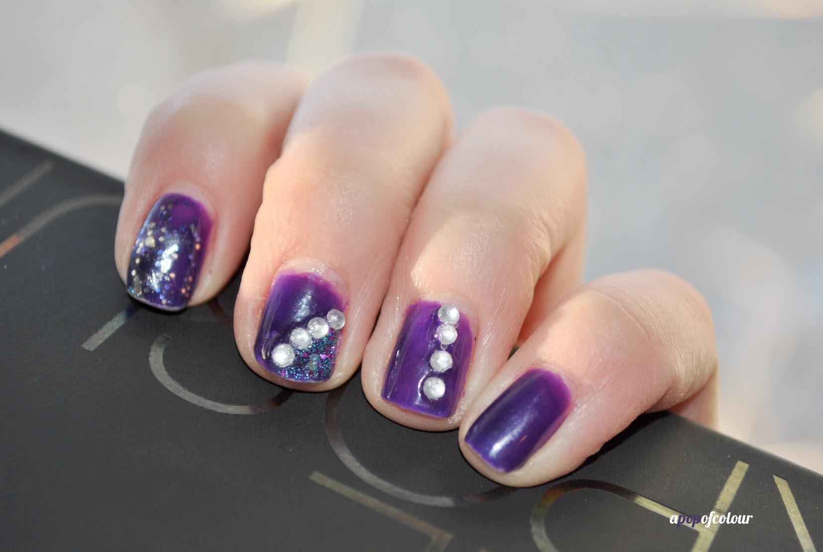Purple Nail Art With Gems