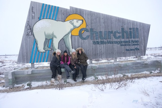 In front of the Churchill sign