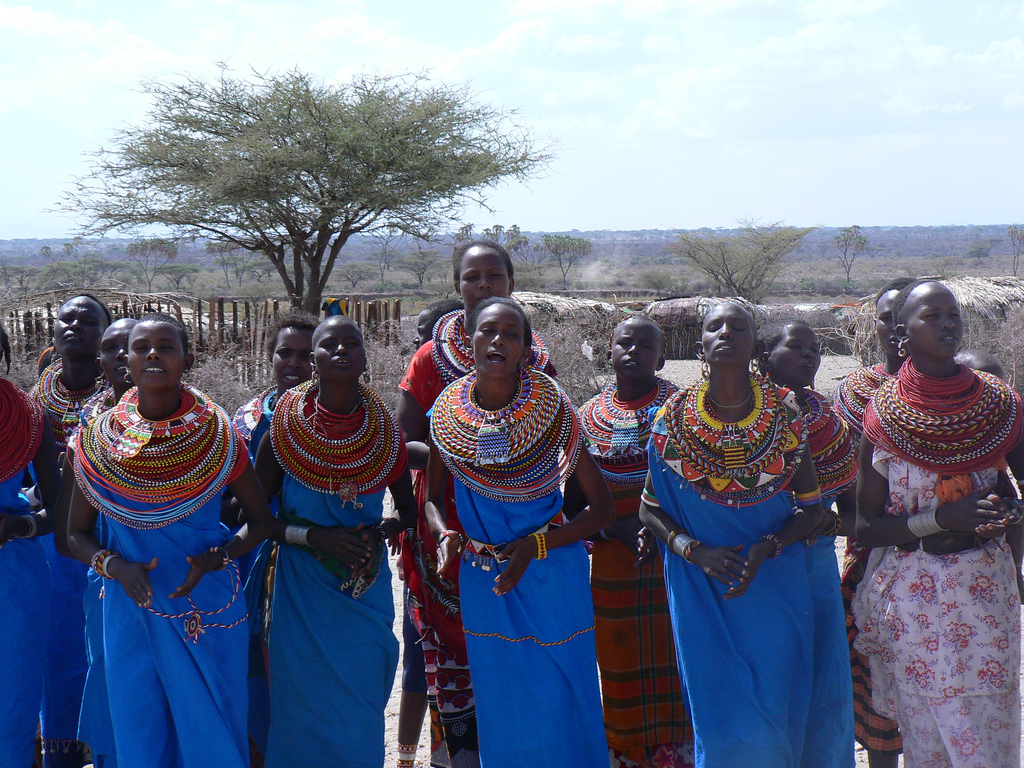 """Samburu women singing"" by Wouter van Vliet - Flickr: P1010736. Licensed under CC BY 2.0 via Commons - https://commons.wikimedia.org/wiki/File:Samburu_women_singing.jpg#/media/File:Samburu_women_singing.jpg"
