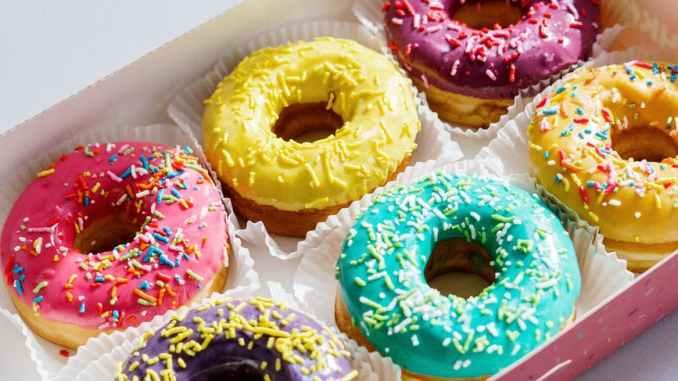 white and pink doughnut on white box