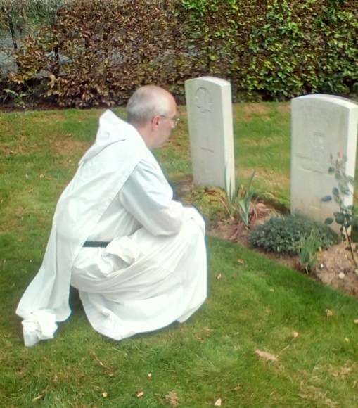 Brother Michael visiting war grave of his great-uncle