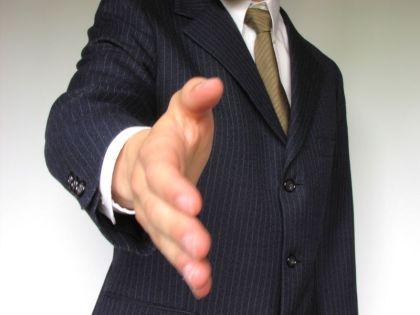 business-man-offering-hand-shake