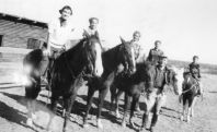 Ann on Grasshopper, Sue on Tack, Grace on Lady Gardner, Rica on Joe, Barb on Baby, with Larry Skylstad, 1950