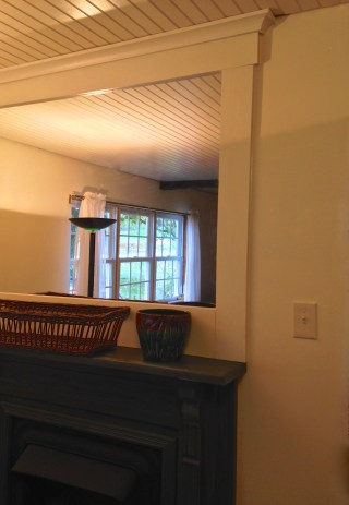 a mirror above the mantel