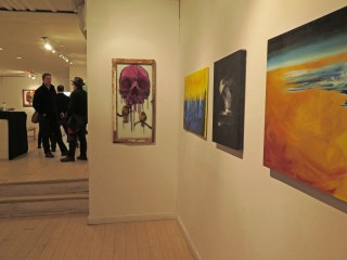 The gorgeous skulls are by Chris Austen. The vibrant landscapes are by Alaa Taher (we chatted earlier in the night).