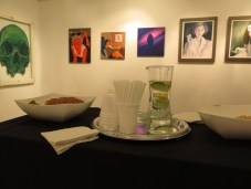 The refreshments table. The orange-and-blue paintings on the wall are by Kolas Balazs.