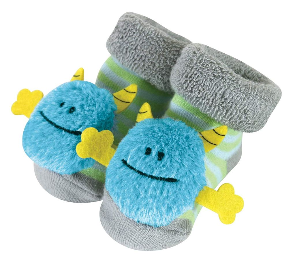 Holiday gift guide for babies 4 and 5 months old. The perfect holiday gift for babies 12 to 20 weeks old. Rattle socks for babies to grab their toes and feet.