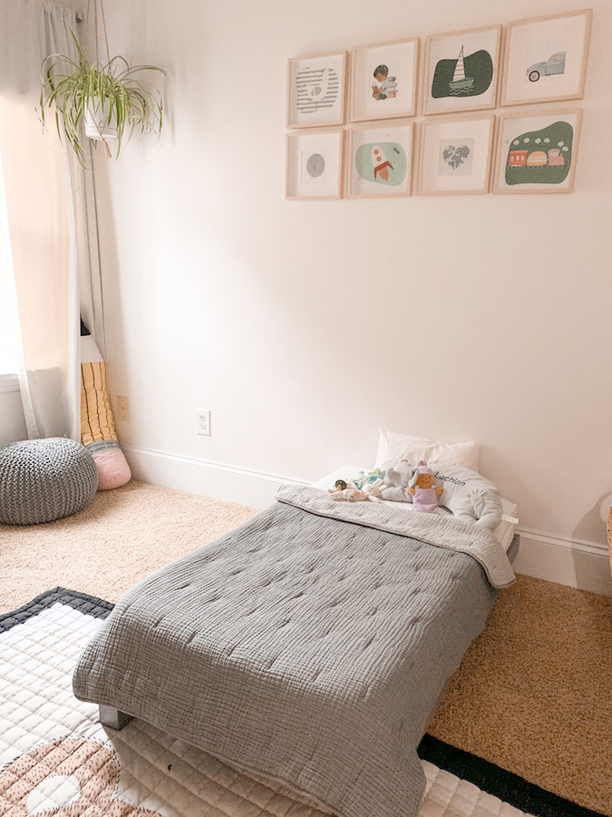 Colorful wall prints above a toddler bed