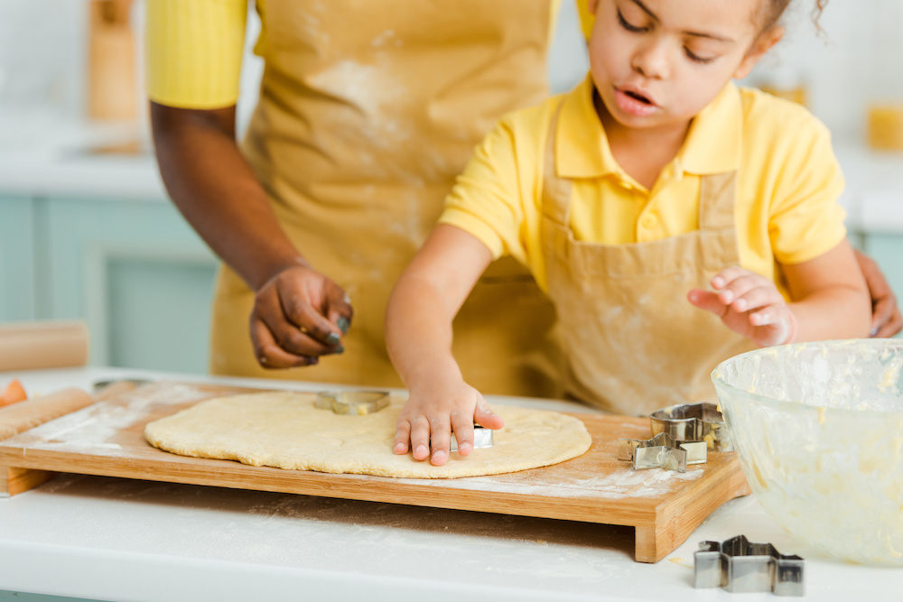 mother cooking with toddlers in the kitchen