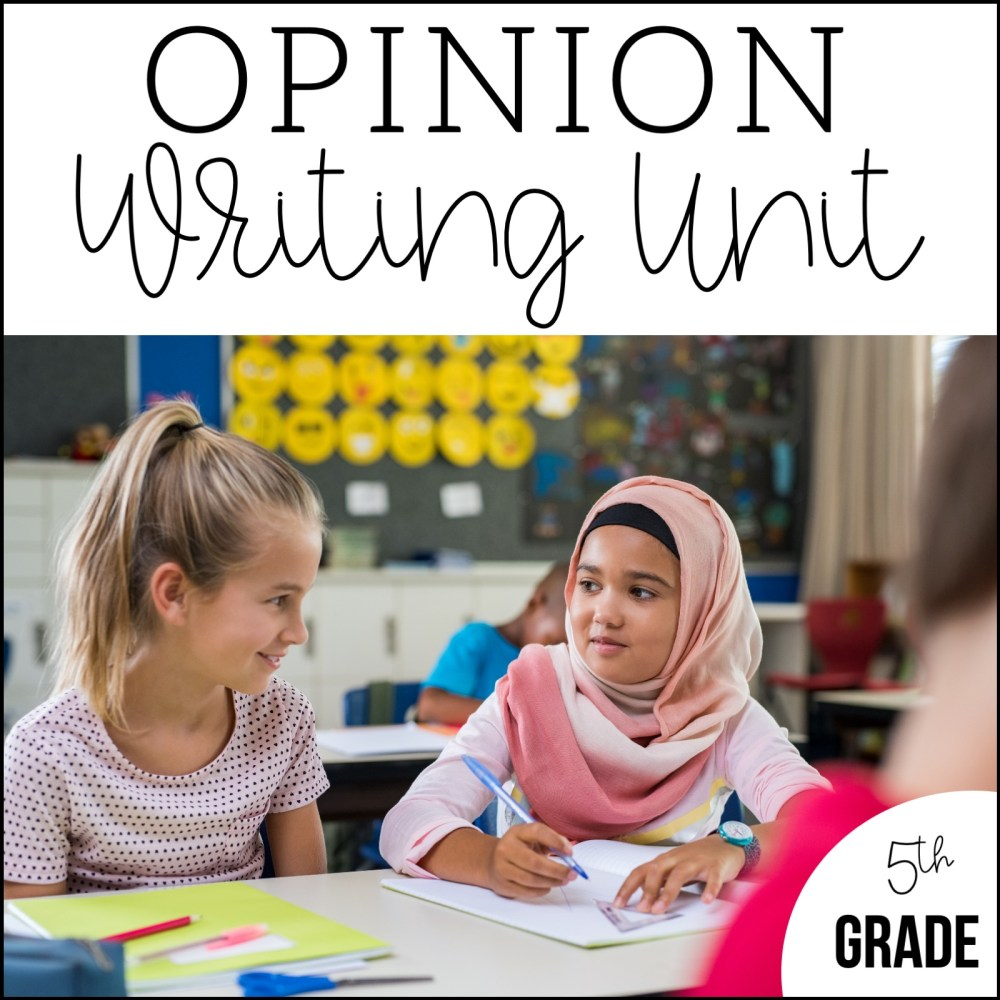 Two students work on forming their opinion during Writer's Workshop