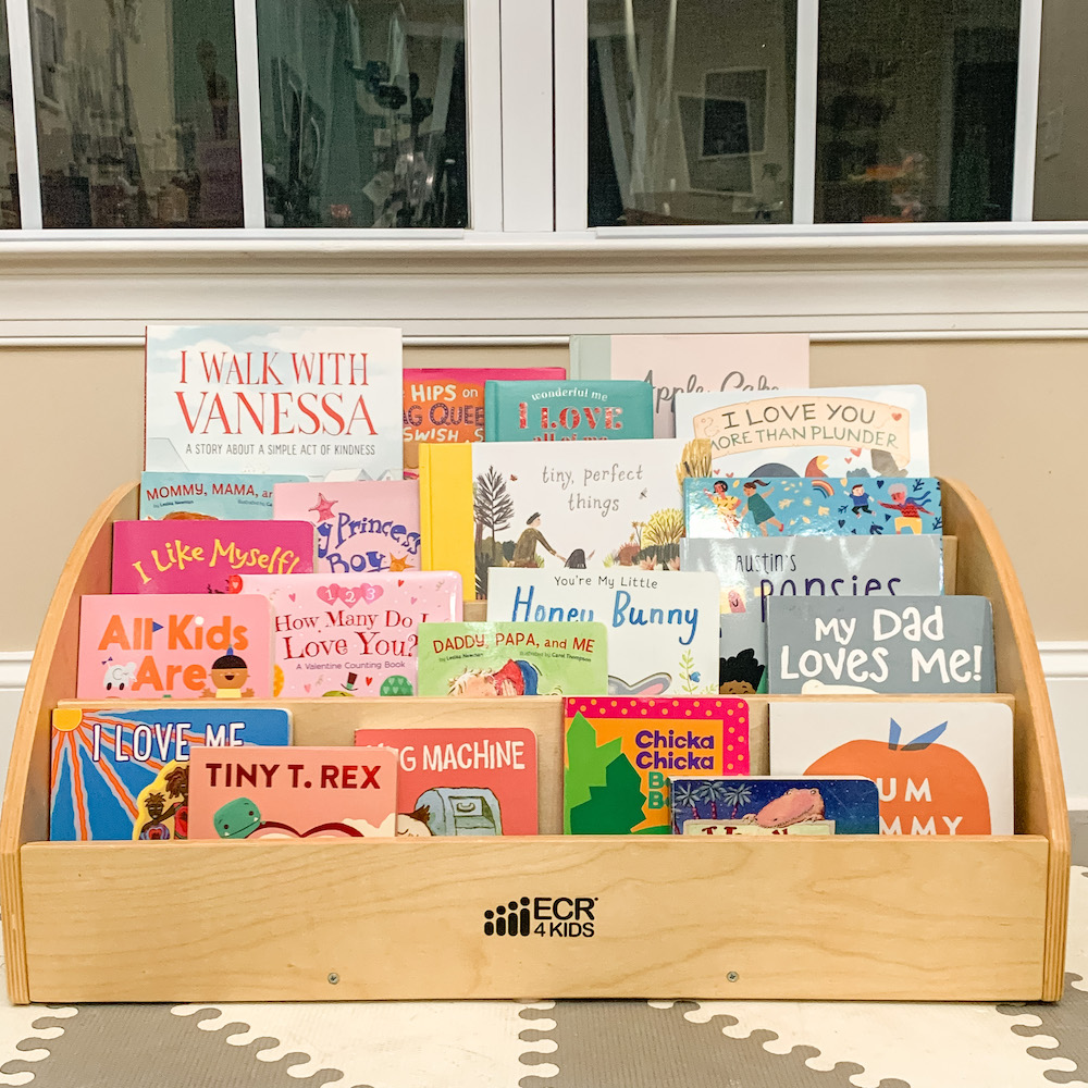 A bookshelf with the best Valentine's Day books for toddlers to celebrate love and kindness.