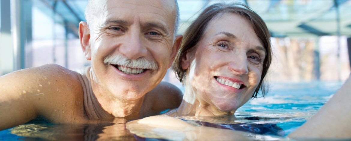 senior couple  relaxing in  hotel pool