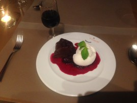 Amazing dessert of chocolate lava cake, lemon sorbet, and wild berry sauce accompanied by port of course.