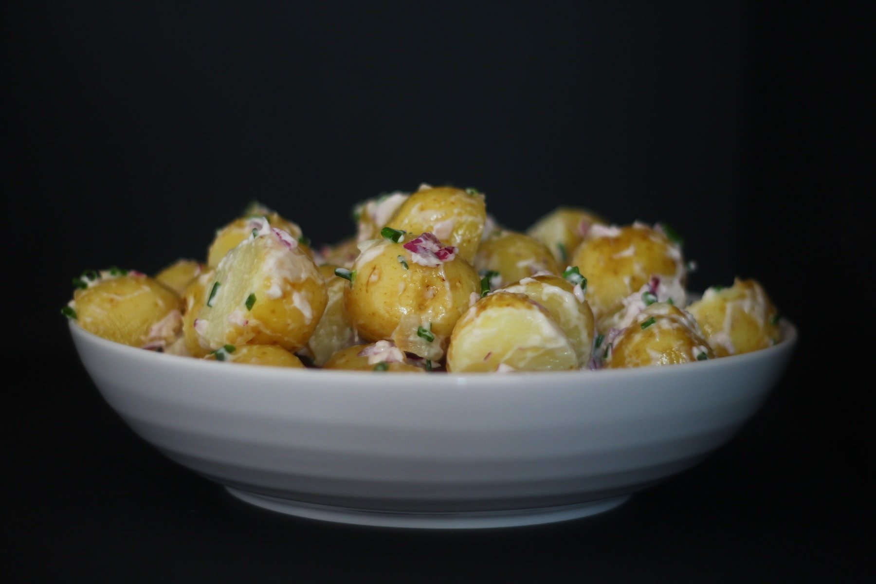 Potato Salad with Mayo Dressing, Red Onion and Chives.