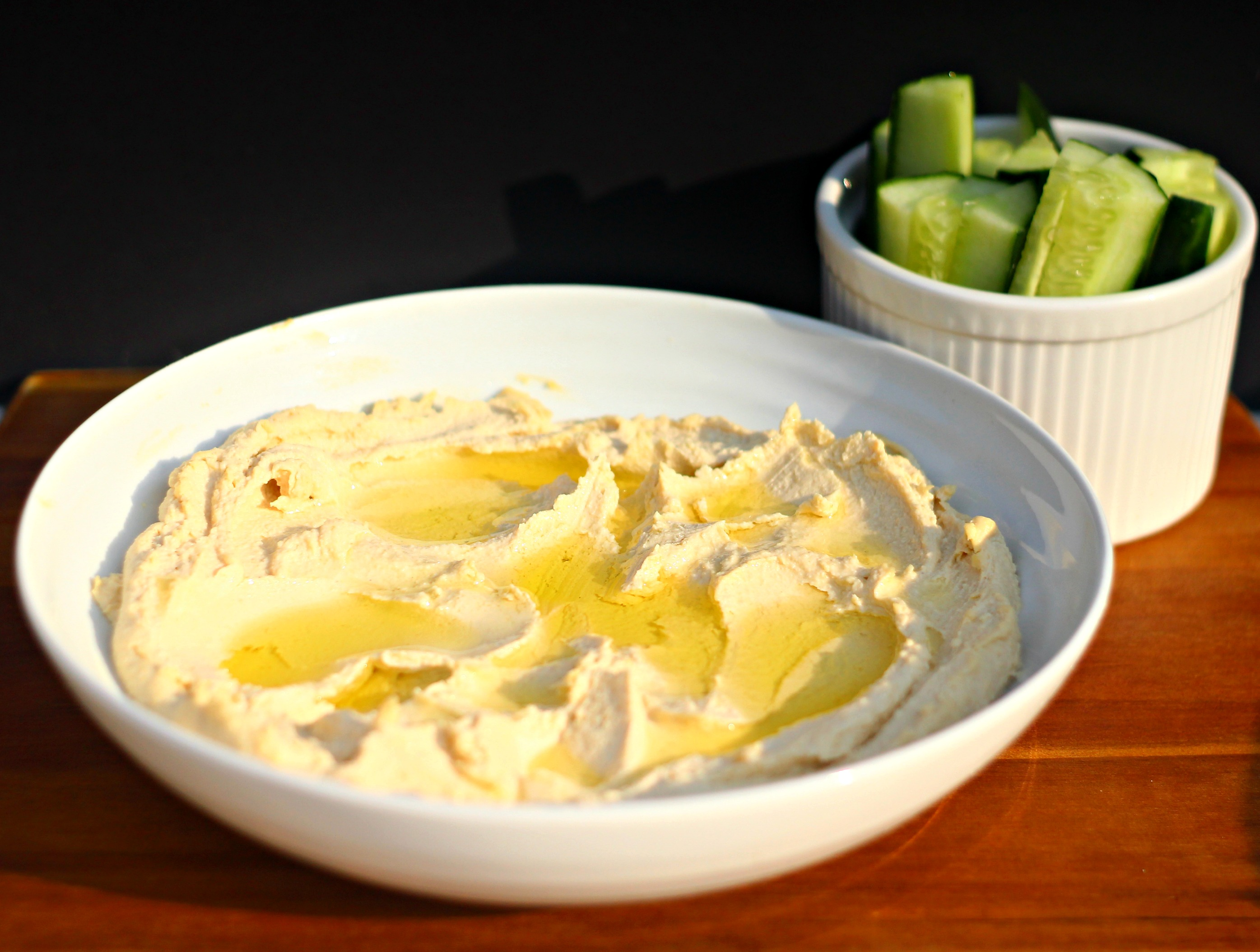 Hummus recipe with olive oil and cucumber sticks