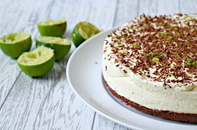 lime no bake cheesecake with bourbon biscuit base and chocolate shavings on top.