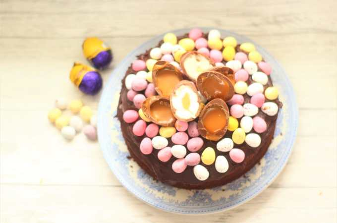 easter chocolate cake decorated with mini eggs and creme chocolate eggs