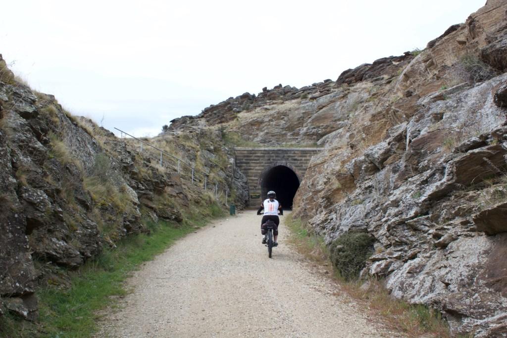 Riding into tunnel Otago Central Rail Trail
