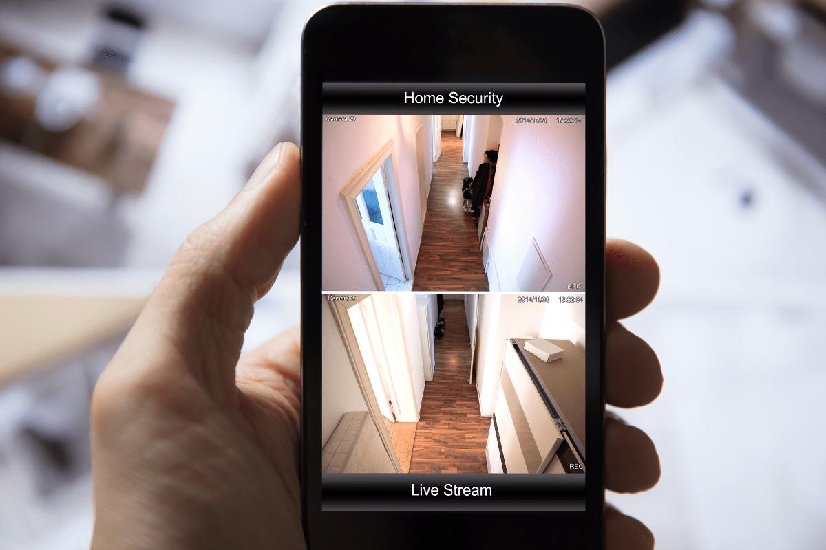man looking at DIY home security app