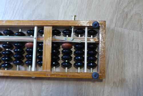 Mécanisme du bouton de remise à zéro du soroban