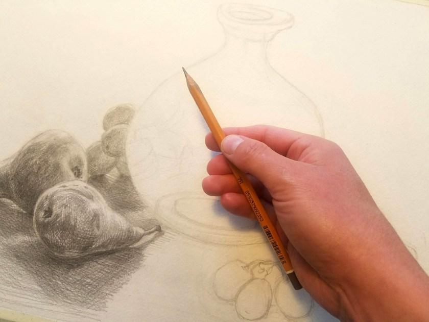Tenir un crayon pour dessiner. première position