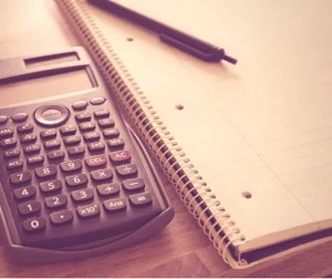 Calculator with a pen and notepad