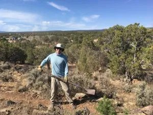 Volunteer with shovel helping to build local trails