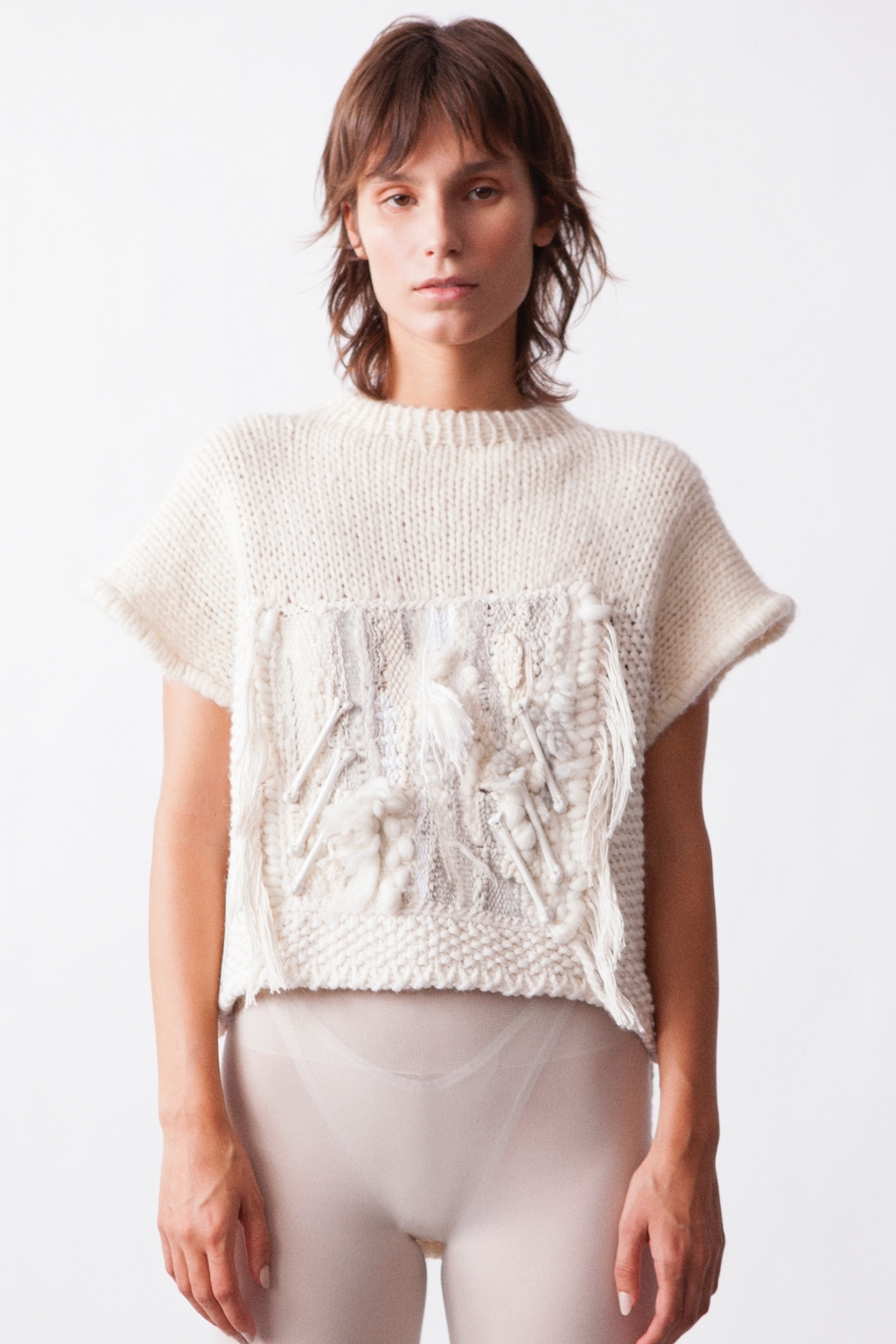 Off white tapestry sleeveless sweater with porcelain bones by ANDRESGALLARDO