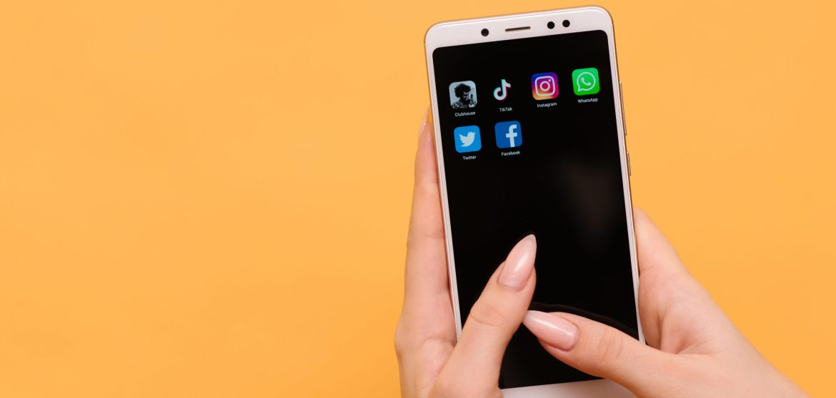 main logo apps clubhouse tik tok instagram facebook whatsapp and twitter on your smartphone screen in female hands scaled - Getting Started in Mobile Marketing