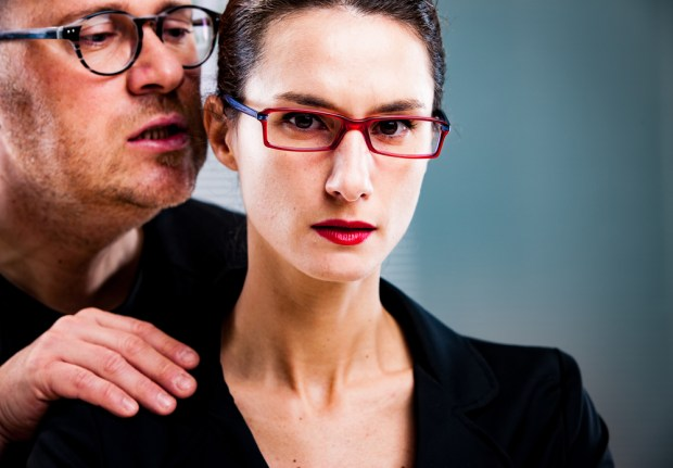 man threatens woman: harassments on the workplace